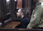 Briton Jack Shepherd sits in a court room in Tbilisi, Georgia, Tuesday, March 26, 2019. A court in Georgia has ruled to extradite a fugitive British man wanted for manslaughter in the case of a woman who was killed during a London date on a speedboat. The court ruled on Tuesday to extradite Jack Shepherd, who was tried in absence and sentenced last year to a six-year prison term. (AP Photo/Shakh Aivazov)