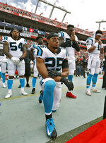 FILE - In this Dec. 2, 2018, file photo, Carolina Panthers strong safety Eric Reid (25) kneels during the playing of the National Anthem before an NFL football game against the Tampa Bay Buccaneers in Tampa, Fla. NFL players who want to kneel during the national anthem to protest police brutality and racism have far more support than Colin Kaepernick did  four years ago. (AP Photo/Mark LoMoglio, File)