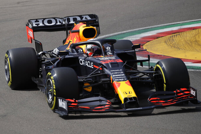 Red Bull driver Max Verstappen of the Netherlands steers his car during qualifying practice for Sunday's Emilia Romagna Formula One Grand Prix, at the Imola track, Italy, Saturday, April 17, 2021. (AP Photo/Luca Bruno)