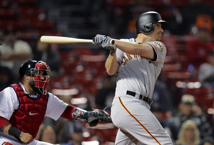 San Francisco Giants' Alex Dickerson watches the flight of his RBI sacrifice fly during the 15th inning of the team's baseball game against the Boston Red Sox at Fenway Park in Boston, early Wednesday, Sept. 18, 2019. (AP Photo/Charles Krupa)