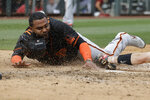 San Francisco Giants' Pablo Sandoval slides safe into home ahead of the tag from Arizona Diamondbacks' John Hicks during the fifth inning of a spring training baseball game, Monday, March 2, 2020, in Scottsdale, Ariz.(AP Photo/Darron Cummings)