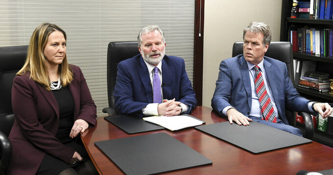 From left, Attorneys Jackie Cook, Mike Cox and David Shea hold a news conference regarding alleged sexual abuse claims by their clients against former University of Michigan doctor, Dr. Robert E. Anderson at the Mike Cox Law Firm office in Livonia, Mich., Wednesday, March 4, 2020. (Robin Buckson/Detroit News via AP)