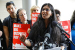 FILE - In this June 12, 2018, file photo, Seattle City Council member Kshama Sawant speaks at City Hall in Seattle. Seven of the nine Seattle City Council seats are up for grabs in next month's election, where retail giant Amazon has made unprecedented donations totaling $1.5 million to a political action committee that's supporting a slate of candidates perceived to be friendlier to business. Among the company's top targets is Sawant, a fierce critic of Amazon, who is running against Egan Orion in the District 3 race. (AP Photo/Ted S. Warren, File)