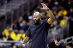 Missouri head coach Cuonzo Martin motions to his players during the first half of an NCAA college basketball game against Butler, Monday, Nov. 25, 2019, in Kansas City, Mo. (AP Photo/Charlie Riedel)