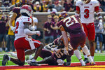Minnesota wide receiver Dylan Wright, center, takes a 25-yard pass into the end zone for a touchdown before Miami-Ohio defensive back Cecil Singleton (2) can stop him as Minnesota running back Bryce Williams (21) runs up to celebrate during the second half of an NCAA college football game on Saturday, Sept. 11, 2021, in Minneapolis. Minnesota won 31-26. (AP Photo/Craig Lassig)