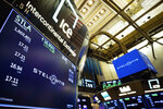 In this photo provided by the New York Stock Exchange, the logo for Stellantis appears above a post on the trading floor, Tuesday, Jan. 19. 2021. Shares start trading in New York in the new auto giant created by the merger of Fiat Chrysler and PSA Peugeot. (Colin Ziemer/New York Stock Exchange via AP)