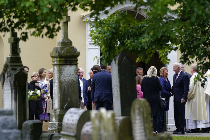 President Joe Biden, right, visits with an attendee as he departs Mass at St. Joseph on the Brandywine Catholic Church, Sunday, May 30, 2021, in Wilmington, Del. (AP Photo/Patrick Semansky)