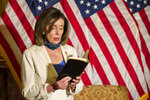 House Speaker Nancy Pelosi of Calif., reads from the Bible, as she reacts to President Donald Trump during a news conference at the U.S. Capitol in Washington, Tuesday, June 2, 2020. (AP Photo/Manuel Balce Ceneta)