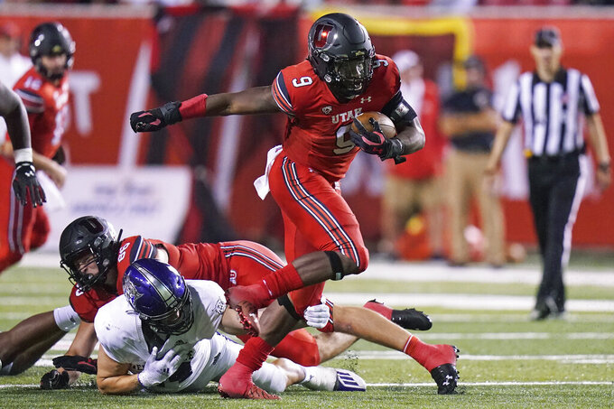 Utah running back Tavion Thomas (9) carries the ball during the second half of the team's NCAA college football game against Weber State on Thursday, Sept. 2, 2021, in Salt Lake City. (AP Photo/Rick Bowmer)