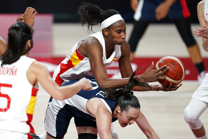 Spain's Astou Ndour, top, grabs a rebound over France's Sarah Michel (10) during a women's basketball quarterfinal round game at the 2020 Summer Olympics, Wednesday, Aug. 4, 2021, in Saitama, Japan. (AP Photo/Charlie Neibergall)