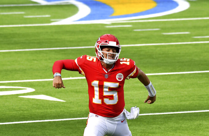 quarterback Patrick Mahomes #15 of the Kansas City Chiefs reacts after throwing a touchdown pass to wide receiver Tyreek Hill (not pictured) against the Los Angeles Chargers in the second half of a NFL football game at SoFi Stadium in Inglewood on Sunday, September 20, 2020. Kansas City Chiefs won 23-20 in overtime. (Keith Birmingham/The Orange County Register via AP)