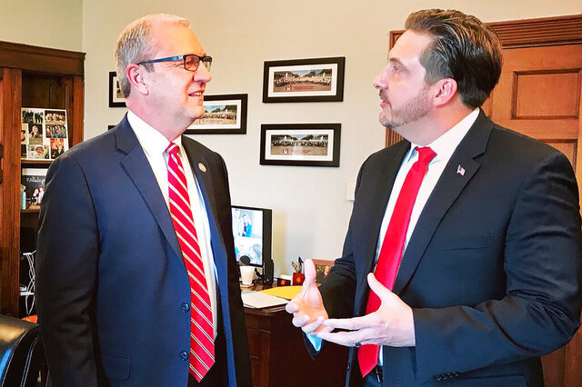 In this Jan. 30, 2019 photo provided by Sen. Kevin Cramer's office, Tommy Fisher, right, talks with Sen. Kevin Cramer, R-N.D., at the lawmaker's office in Washington, D.C. Fisher runs Fisher Sand & Gravel, the North Dakota company that won a $400 million contract to build part of the border wall. But the contract is now being audited over concern it may not meet requirements.  (Sen. Kevin Cramer's office via AP)