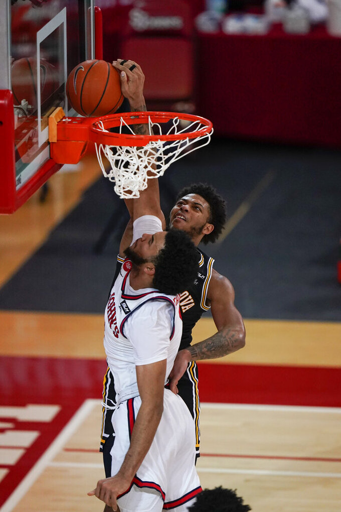 St. John'sJulian Champagnie, left, blocks a shot by Villanova's Justin Moore during the second half of an NCAA college basketball game Wednesday, Feb. 3, 2021, in New York. (AP Photo/Frank Franklin II)