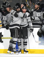 Los Angeles Kings left wing Ilya Kovalchuk, center, celebrates his goal with defenseman Drew Doughty during the second period of an NHL hockey game against the Boston Bruins on Saturday, Feb. 16, 2019, in Los Angeles. (AP Photo/Mark J. Terrill)