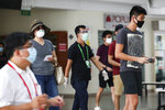 Voters, wearing facemasks, arrive at the Chung Cheng High School polling center to cast their votes in Singapore, Friday, July 10, 2020. Singaporeans began voting in a general election that is expected to return Prime Minister Lee Hsien Loong's long-governing party to power. (AP Photo)