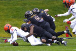 Illinois defensive back Devon Witherspoon, left, tries to recover a fumble against Northwestern during the first half of an NCAA college basketball game in Evanston, Ill., Saturday, Dec. 12, 2020. (AP Photo/Nam Y. Huh)