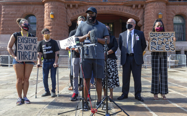 Mathias Ometu speaks outside the Bexar County Courthouse Wednesday, Sept. 2, 2020 to the media in San Antonio, Texas.  Police officers detained Ometu while he was jogging on Aug. 28,  as a suspect in a nearby domestic violence call, saying he resembled a sketchy description given by the complainant. However, the complainant refused to come to the scene immediately to positively identify Ometu.  The delay in his positive identification led to a two-day jail stay until he was cleared. (William Luther/The San Antonio Express-News via AP)
