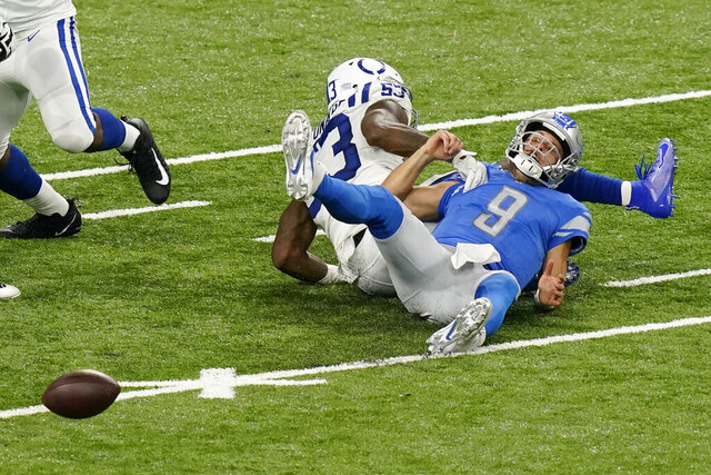 Detroit Lions quarterback Matthew Stafford (9) fumbles the ball after being tackled by Indianapolis Colts outside linebacker Darius Leonard (53) during the second half of an NFL football game, Sunday, Nov. 1, 2020, in Detroit. (AP Photo/Carlos Osorio)