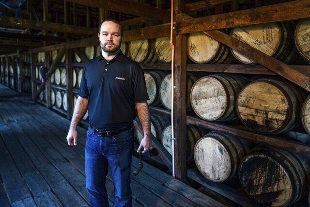 This photo provided by Brown-Forman Corporation/Lack Daniel Distillery shows Chris Fletcher, the new master distiller at Jack Daniel's.  The Tennessee distillery introduced Fletcher as master distiller for the flagship brand of Kentucky-based Brown-Forman Corp., on Wednesday, Oct. 7, 2020.  Fletcher spent six years as assistant master distiller and assumes the top role following Jeff Arnett's departure after 12 years of leading the powerhouse brand.   (Ed Rode/Brown-Forman Corporation/Lack Daniel Distillery via AP)