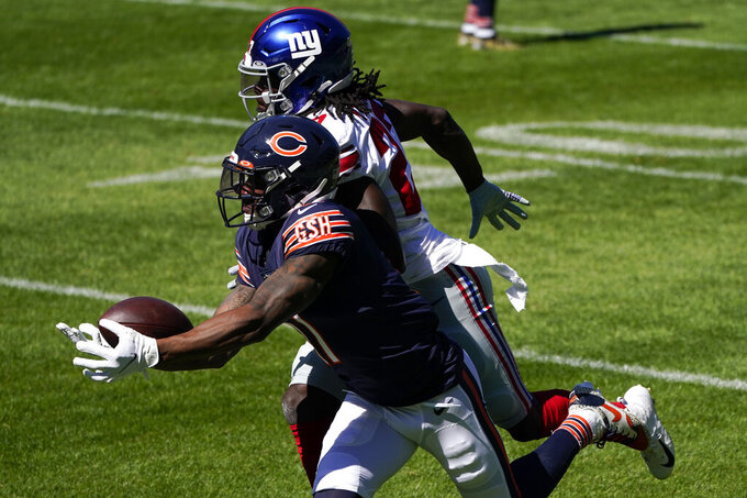 Chicago Bears wide receiver Anthony Miller (17) tries to catch a pass as New York Giants cornerback Isaac Yiadom (27) defends during the first half of an NFL football game in Chicago, Sunday, Sept. 20, 2020. (AP Photo/Charles Rex Arbogast)
