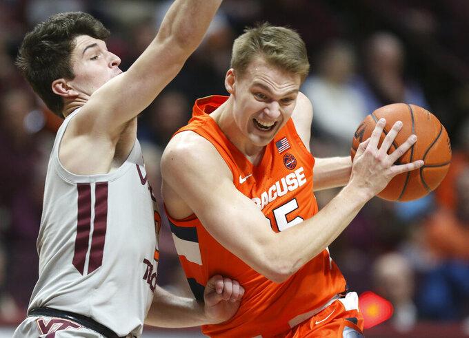 Syracuse's Buddy Boeheim (35) drives on Virginia Tech's Hunter Cattoor (0) during the first half of an NCAA college basketball game in Blacksburg Va., Saturday, Jan. 18 2020. (Matt Gentry/The Roanoke Times via AP)