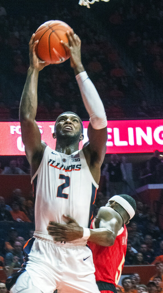 Illinois forward Kipper Nichols (2) is fouled by Nebraska guard Glynn Watson Jr. (5) during the second half of an NCAA college basketball game in Champaign, Ill., Saturday. Feb. 2, 2019. (AP Photo/Robin Scholz)