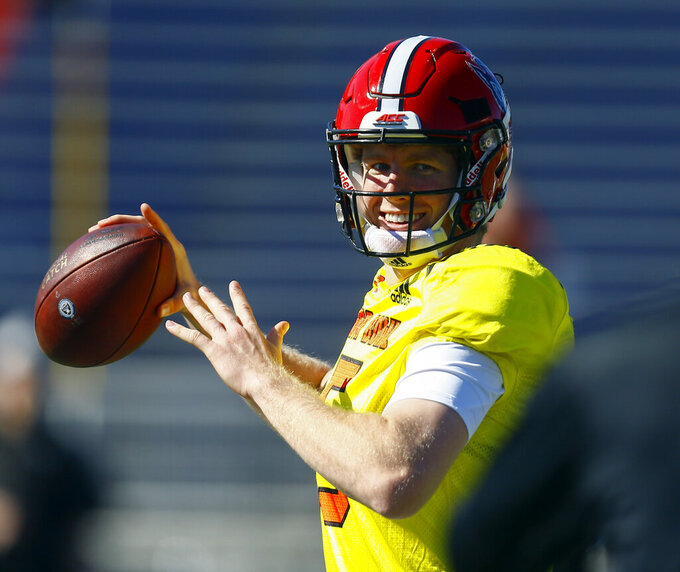 North quarterback Ryan Finley of North Carolina State (15) throws a pass during practice for Saturday's Senior Bowl NCAA college football game, Thursday, Jan. 24, 2019, in Mobile, Ala. (AP Photo/Butch Dill)