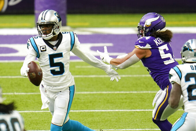 Carolina Panthers quarterback Teddy Bridgewater (5) runs from Minnesota Vikings linebacker Eric Kendricks (54) during the first half of an NFL football game, Sunday, Nov. 29, 2020, in Minneapolis. (AP Photo/Jim Mone)