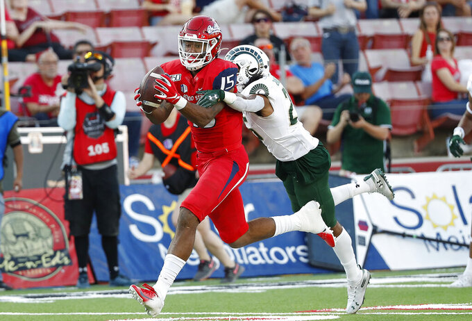 Fresno State tight end Cam Sutton catches a long pass to set up a touchdown past Colorado State cornerback Keevan Bailey during the first half of an NCAA college football game in Fresno, Calif., Saturday, Oct. 26 2019. (AP Photo/Gary Kazanjian)
