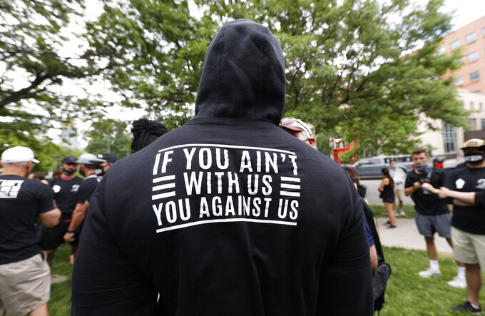 Denver Broncos linebacker Von Miller displays a message on the back of his hoodie as he takes part in a rally with teammates in the Greek Amphitheatre in Civic Center Park over the death of George Floyd Saturday, June 6, 2020, in downtown Denver. (AP Photo/David Zalubowski)