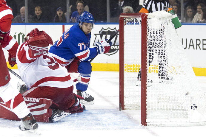 New York Rangers defenseman Tony DeAngelo (77) scores a goal past Detroit Red Wings goaltender Jimmy Howard (35) during the second period of an NHL hockey game, Wednesday, Nov. 6, 2019, at Madison Square Garden in New York. (AP Photo/Mary Altaffer)