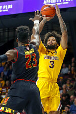 Minnesota forward Jordan Murphy (3) shoots over Maryland forward Bruno Fernando (23) during an NCAA college basketball game Tuesday, Jan. 8, 2019, in Minneapolis. (AP Photo/Bruce Kluckhohn)