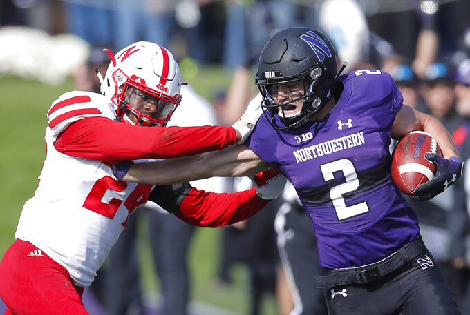 Northwestern's Flynn Nagel, right, pushes off Nebraska's Aaron Williams during the second half of an NCAA college football game Saturday, Oct. 13, 2018, in Evanston, Ill.. (AP Photo/Jim Young)