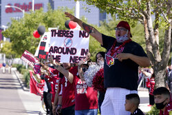 Arizona Cardinals fans cheer outside State Farm Stadium as teams arrive prior to an NFL football game against the Detroit Lions, Sunday, Sept. 27, 2020, in Glendale, Ariz. (AP Photo/Ross D. Franklin)