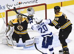 Boston Bruins goaltender Tuukka Rask (40) makes a glove save as Tampa Bay Lightning center Blake Coleman (20) and Bruins defenseman Zdeno Chara (33) look on during the second period of an NHL Stanley Cup playoff hockey game in Toronto, Ontario, Wednesday, Aug. 5, 2020. (Nathan Denette/The Canadian Press via AP)