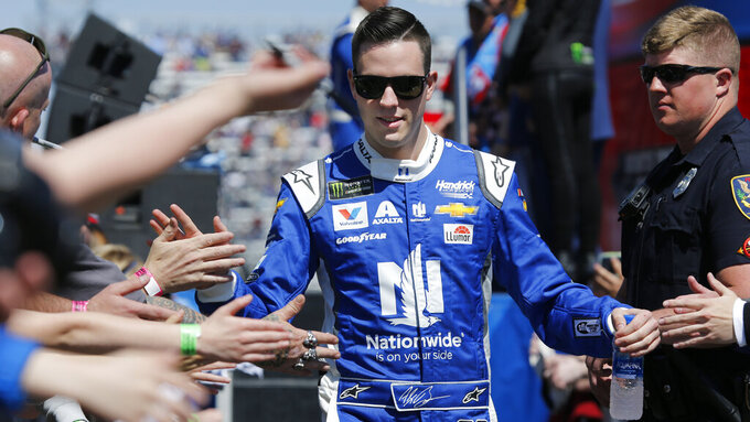 NASCAR Cup Series driver Alex Bowman (88) greets fans during driver introductions prior to the NASCAR Cup Series auto race at the Martinsville Speedway in Martinsville, Va., Sunday, March 24, 2019. (AP Photo/Steve Helber)