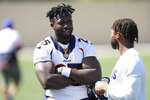 Denver Broncos running back Melvin Gordon, left, talks with wide receiver Diontae Spencer after an NFL football training camp at the team's headquarters Thursday, Aug. 19, 2021, in Englewood, Colo. (AP Photo/David Zalubowski)