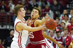 Wisconsin's Tyler Wahl (5) passes against Indiana's Race Thompson (25) during the first half of an NCAA college basketball game Saturday, Dec. 7, 2019, in Madison, Wis. (AP Photo/Andy Manis)