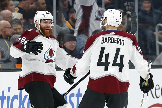 Colorado Avalanche's Ian Cole (28) celebrates his goal with Mark Barberio (44) during the second period of the team's NHL hockey game against the Boston Bruins in Boston, Saturday, Dec. 7, 2019. (AP Photo/Michael Dwyer)