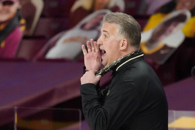 Purdue coach Matt Painter yells instructions during the second half of the team's NCAA college basketball game against Minnesota, Thursday, Feb. 11, 2021, in Minneapolis. (AP Photo/Jim Mone)