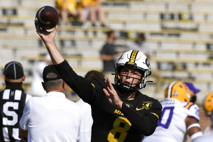 Missouri quarterback Connor Bazelak warms up before the start of an NCAA college football game between LSU and Missouri Saturday, Oct. 10, 2020, in Columbia, Mo. (AP Photo/L.G. Patterson)