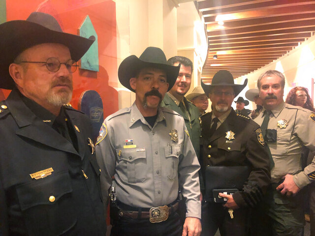 A group of New Mexico sheriffs stand outside the New Mexico Senate in Santa Fe, N..M., on Tuesday, Jan. 28, 2019, before a committee debates proposals on gun control and legalizing marijuana. (AP Photo/Russell Contreras)