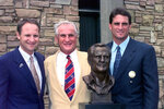 FILE - In this July 26, 1997, file photo, Don Shula, center, stands with his sons David, left, and Mike after being enshrined into the Pro Football Hall of Fame in Canton, Ohio. Shula, who won the most games of any NFL coach and led the Miami Dolphins to the only perfect season in league history, died Monday, May 4, 2020, at his home in Indian Creek, Fla., the team said. He was 90. (AP Photo/Mark Duncan, File)