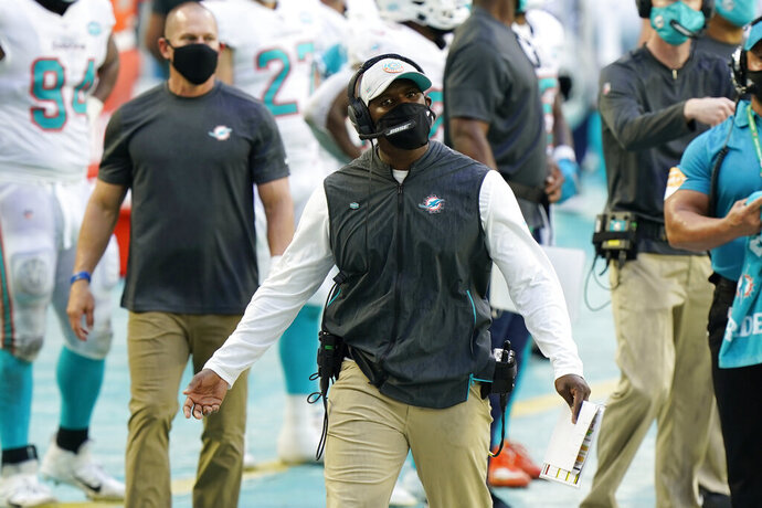 Miami Dolphins head coach Brian Flores gestures during the first half of an NFL football game against the New York Jets, Sunday, Oct. 18, 2020, in Miami Gardens, Fla. (AP Photo/Wilfredo Lee)