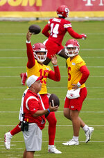 Kansas City Chiefs quarterback Patrick Mahomes (15) passes the ball during drills at the team's NFL football training camp Saturday, July 31, 2021 in St. Joseph, Mo. (AP Photo/Ed Zurga)
