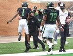 North Texas running head coach Seth Litrell picks up wide receiver Jaelon Darden (1) after Darden scored a touchdown during an NCAA college football game against Rice, Saturday, Nov. 21, 2020, in Denton, Texas. (Al Key/The Denton Record-Chronicle via AP)