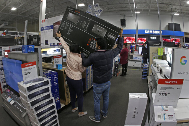 FILE - In this Nov. 28, 2019, file photo people shop at a Best Buy store during a Black Friday sale in Overland Park, Kan. On Monday, Dec. 23, the Commerce Department releases its November report on durable goods. (AP Photo/Charlie Riedel, File)