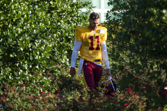 Washington quarterback Alex Smith (11) walks to practice at the team's NFL football training facility, Tuesday, Aug. 18, 2020, in Ashburn, Va. (AP Photo/Alex Brandon)