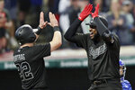 Cleveland Indians' Franmil Reyes, right, is congratulated by Jason Kipnis after hitting a three-run home run in the third inning in a baseball game against the Kansas City Royals, Saturday, Aug. 24, 2019, in Cleveland. (AP Photo/Tony Dejak)