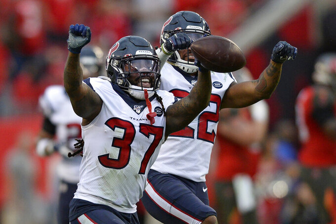 Houston Texans strong safety Jahleel Addae (37) celebrates with cornerback Gareon Conley (22) after Addae intercepted a pass by Tampa Bay Buccaneers quarterback Jameis Winston during the second half of an NFL football game Saturday, Dec. 21, 2019, in Tampa, Fla. (AP Photo/Jason Behnken)